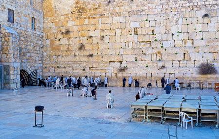 hasid: The Hasidic Orthodox jews pray at the Western Wall in Ha Kotel Square, Jerusalem, Israel.