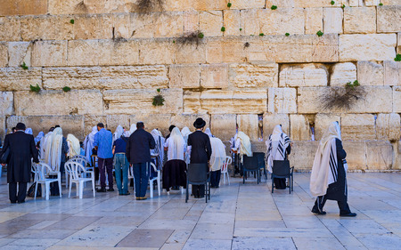 hasid: The group of Hasidic Orthodox jewa, dressed in tallits, pray at the Western Wall, Jerusalem, Israel.