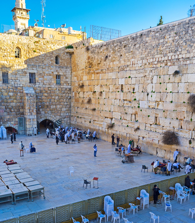 hasid: JERUSALEM, ISRAEL - FEBRUARY 16, 2016: The Western Wall with the fence, separating men and women sections for pray, on February 16 in Jerusalem.