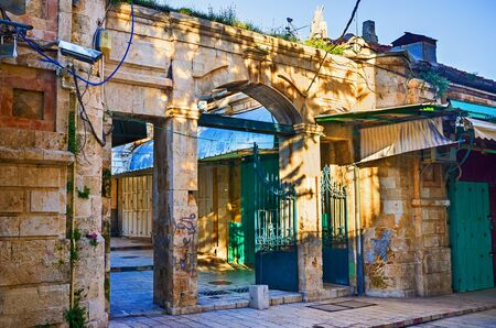 The Aftimos bazaar separated by the old stone gateways from the neighboring streets, Jerusalem, Israel.