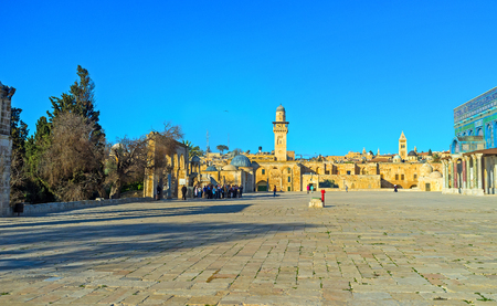 dome of the rock: JERUSALEM, ISRAEL - FEBRUARY 16, 2016: The large square next to the Dome of the Rock with the stone walls and belfries of the old city on the background, on February 16 in Jerusalem.