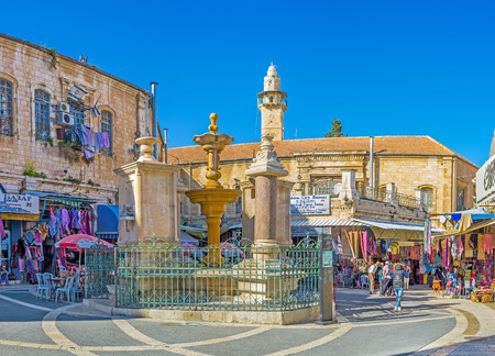 suq: JERUSALEM, ISRAEL - FEBRUARY 16, 2016: The Muristan Square is the heart of the noisy Aftimos Suq with its interesting stalls and cozy cafes, on February 16 in Jerusalem.