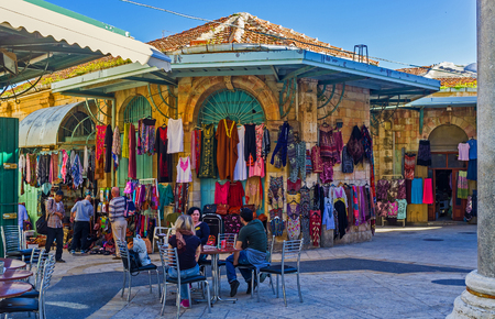 suq: JERUSALEM, ISRAEL - FEBRUARY 16, 2016: The stalls of the Aftimos Suq offers the colorful eastern clothes and interesting souvenirs, on February 16 in Jerusalem.