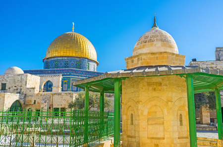 The medieval public fountain Qubbet Musa with the golden cupola of the Dome of the Rock on the background, Jerusalem, Israel. Stock Photo