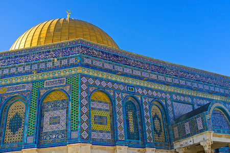 jerusalem: The Dome of the Rock decorated with colorful glazed tiles, covered with geometric islamic patterns and Quranic calligraphy, Jerusalem, Israel.