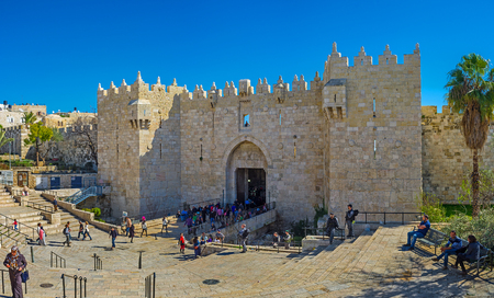 exits: JERUSALEM, ISRAEL - FEBRUARY 16, 2016: The Damascus Gate is one of the most crowded city exits, because behind it hides the local market, on February 16 in Jerusalem.