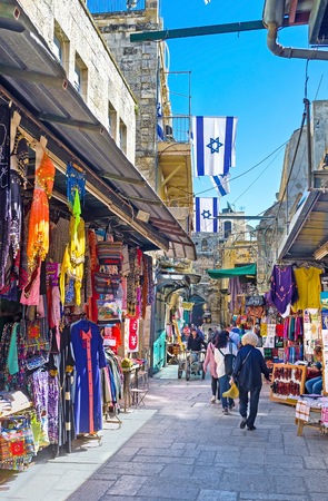 suq: JERUSALEM, ISRAEL - FEBRUARY 16, 2016: At least a half of the streets of the old walled city are occupied by the traditional eastern markets (suq) with wide range of the different goods, on February 16 in Jerusalem. Editorial