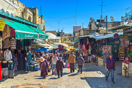 souq: JERUSALEM, ISRAEL - FEBRUARY 16, 2016: The crowded Arab Souq at Damascus Gate is one of the noisiest and most interesting locations in the walled city, on February 16 in Jerusalem.