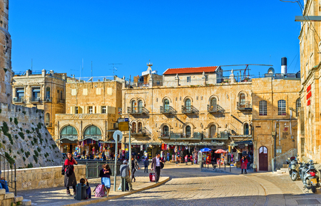 omar: JERUSALEM, ISRAEL - FEBRUARY 16, 2016: The tourist street of Omar Ben el-Hatab connects such notable landmarks as Jaffa Gate, King Davids Tower and old Bazaar on Davids street, on February 16 in Jerusalem.