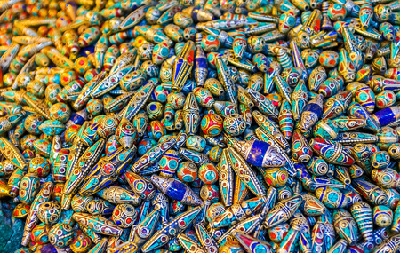 corall: The colorful stone beads covered with the silver wire, Jerusalem, Israel.