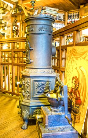 potbelly: ODESSA, UKRAINE - MAY 18, 2015: The cast iron potbelly stove is an element of decoration of the local cafe in old Odessa, on May 18 in Odessa. Editorial