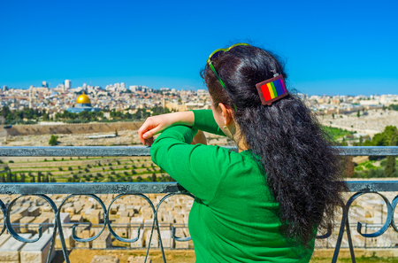 jerusalem: The girl enjoys the view on the old Jerusalem, standing at the viewpoint of the Mount of Olives, Israel.