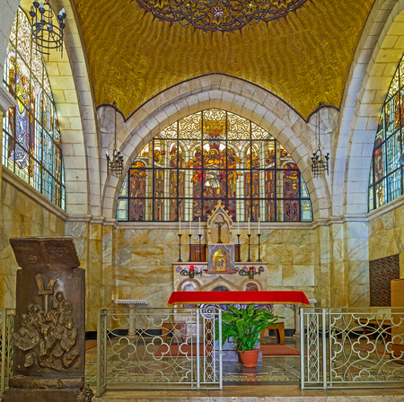 jerusalem: JERUSALEM, ISRAEL - FEBRUARY 16, 2016: The altar of the Church of the Flagellation with the scenic stained-glass window, decorated with icon, on February 16 in Jerusalem. Editorial