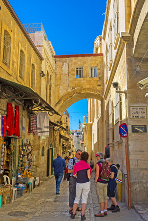 via dolorosa: JERUSALEM, ISRAEL - FEBRUARY 16, 2016: The way of Jesus Christ to Calvary, named Via Dolorosa is the crowded place, full of pilgrims, tourists and locals, on February 16 in Jerusalem.