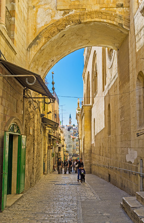 via dolorosa: JERUSALEM, ISRAEL - FEBRUARY 16, 2016: The Via Dolorosa is the narrow street inside the walled town, that leads from the Lions Gate to the Church of the Holy Sepulchre and shows the way of Christ, on February 16 in Jerusalem.
