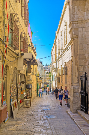 via dolorosa: JERUSALEM, ISRAEL - FEBRUARY 16, 2016: The narrow Via Dolorosa is very crowded during the Christian Holidays and completely empty in low season, on February 16 in Jerusalem. Editorial