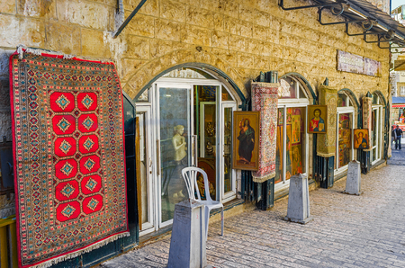 via dolorosa: JERUSALEM, ISRAEL - FEBRUARY 16, 2016: The souvenir store on Via Dolorosa offers old icons and other religious goods, on February 16 in Jerusalem. Editorial