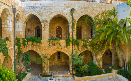 redeemer: JERUSALEM, ISRAEL - FEBRUARY 16, 2016: Panorama of the courtyard of Lutheran Kirche of the Redeemer and its beautiful garden, on February 16 in Jerusalem.