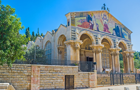 jerusalem: The facade of the All Nations Church decorated with colorful mosaic icon, Jerusalem, Israel.