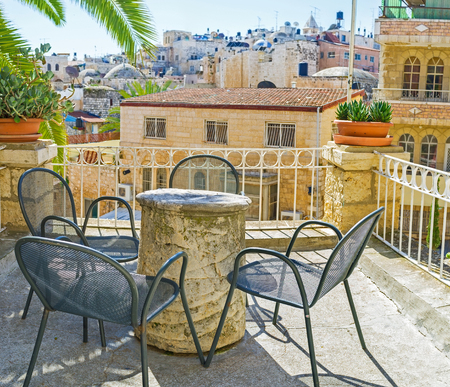 jerusalem: The street terrace, overlooking the city roofs, is the best place to relax in shade, Jerusalem, Israel. Stock Photo