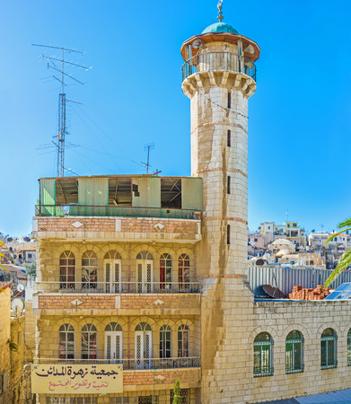hamam: The white mosque with the high minaret, located opposite the Austrian Hospice in the Muslim Quarter of Jerusalem, Israel.