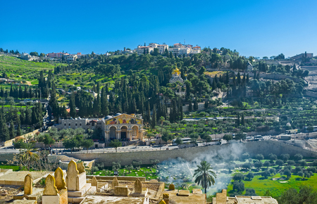 mount of olives: The view from the Muslim Cemetery on the slope of Mount of Olives with the Gethsemane Garden, Churches of All Nations, Mary Magdalene and Dominus Flevit, Jerusalem, Israel.