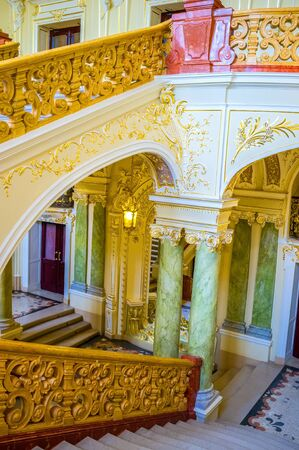telamon: ODESSA, UKRAINE - MAY 17, 2015: The principal staircases of the Opera house are made in rococo style, on May 17 in Odessa. Editorial