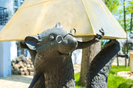 literary: ODESSA, UKRAINE - MAY 18, 2015: The sculpture of the rats that hold the pyramid in the courtyard of the Odessa Literary Museum, on May 18 in Odessa.