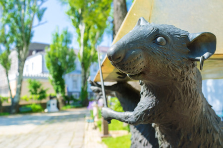 literary: ODESSA, UKRAINE - MAY 18, 2015: The element of the sculpture of the rats that hold the piramid in the courtyard of the Odessa Literary Museum, on May 18 in Odessa.