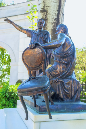 literary: ODESSA, UKRAINE - MAY 18, 2015: The sculpture to the famous soveit writers Ilf and Petrov in the courtyard of the Odessa Literary Museum, on May 18 in Odessa.
