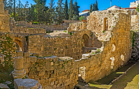 bethesda: The stone walls of the ruined Byzantine Basilica at the archaeological site of Bethesda Pool, Jerusalem, Israel.