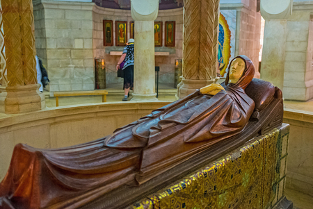 crypt: JERUSALEM, ISRAEL - FEBRUARY 16, 2016:  The wooden statue of the Dormition of Virgin Mary in the center of the crypt in Dormition Church, on February 16 in Jerusalem.