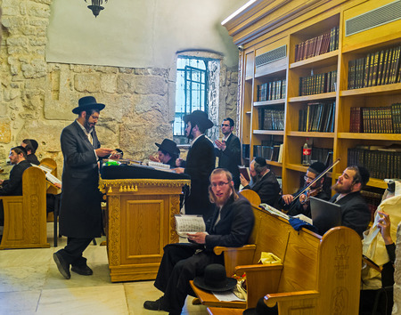hasid: JERUSALEM, ISRAEL - FEBRUARY 16, 2016: The ultra orthodox worshipers pray, sing, play the violin and dance in the synagogue at the King Davids Tomb, on February 16 in Jerusalem