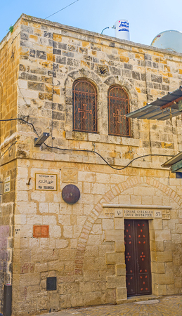 via dolorosa: JERUSALEM, ISRAEL - FEBRUARY 16, 2016: The Franciscan Church of Simon the Cyrenian is the fifth station on Via Dolorosa street, the way of Jesus and pilgrims route, on February 16 in Jerusalem.