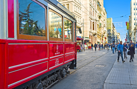 tunel: ISTANBUL, TURKEY - JANUARY 22, 2015: The main transport in Independence Avenue is the retro tram of Nostalgia Tramway, connecting the Taksim Square and Tunel, on January 22 in Istanbul. Editorial