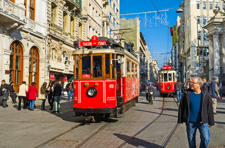 tunel: ISTANBUL, TURKEY - JANUARY 22, 2015: The red retro trams in Independence Avenue departed in different directions: one - to the Taksim Square, another - to the Tunel, on January 22 in Istanbul.