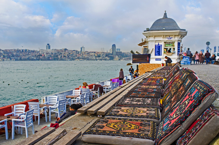 teahouse: ISTANBUL, TURKEY - JANUARY 21, 2015: The traditional Turkish lounges in the outdoor teahouse, located on Uskudar embankment, on January 21 in Istanbul.