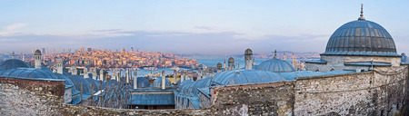 beyoglu: The grey domes of the Suleymaniye Burial Complex with the view on the Beyoglu district inthe sunset beams, Istanbul, Turkey. Editorial
