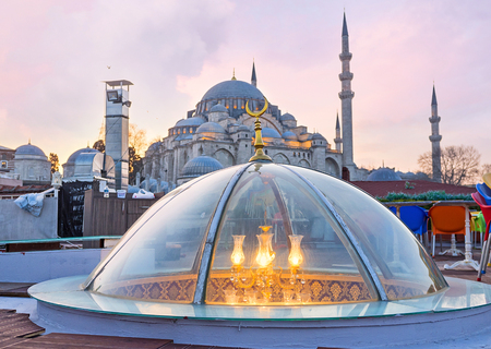 suleymaniye: The transparent glass dome with the chandelier inside and the great Suleymaniye Mosque on the background, Istanbul, Turkey.