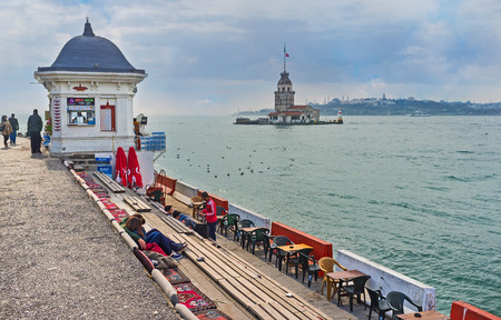 teahouse: ISTANBUL, TURKEY - JANUARY 21, 2015: The cozy teahouse on the Uskudar embankment offers the hot beverages, and scenic view on Bosphorus and the Maidens Tower, on January 21 in Istanbul.