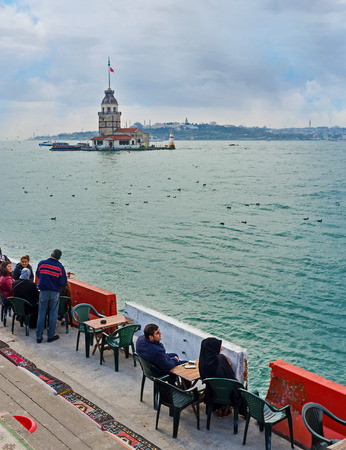 teahouse: ISTANBUL, TURKEY - JANUARY 21, 2015: The outdoor teahouse on the Uskudar embankment is the best place to relax with a view on the Maidens Tower, on January 21 in Istanbul.