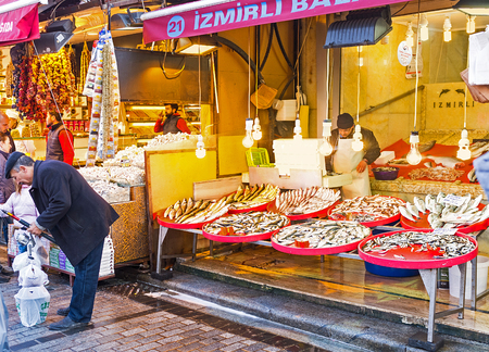eminonu: ISTANBUL, TURKEY - JANUARY 21, 2015: The fish stall in Egyptian Bazaar offers the vide range of the local fish, caught in Bosphorus or Golden Horn Bay, on January 21 in Istanbul. Editorial