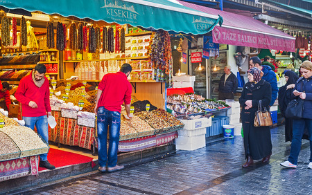 eminonu: ISTANBUL, TURKEY - JANUARY 21, 2015: The Egyptian Bazaar is the popular tourist attraction in the city center, on January 21 in Istanbul.