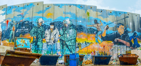 BETHLEHEM, PALESTINE - FEBRUARY 18, 2016: The mural on the separation wall next to the refugee camp in Bethlehem, on February 18 in Bethlehem.