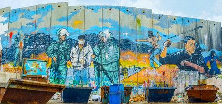 conflictos sociales: Belén, Palestina - 18 de febrero, 2016: El mural en la pared de separación al lado del campo de refugiados en Belén, el 18 de febrero en Belén. Editorial
