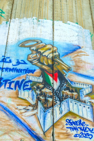 guerilla: BETHLEHEM, PALESTINE - FEBRUARY 18, 2016: The key is a symbol of hopes of returning home, and a popular element in murals on the wall, on February 18 in Bethlehem.