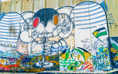 guerilla warfare: BETHLEHEM, ISRAEL - FEBRUARY 18, 2016: The abstract mural with a difficult understanding sense on the separation wall, on February 18 in Bethlehem.