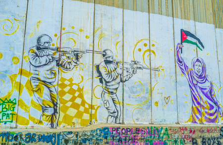 partisan: BETHLEHEM, PALESTINE - FEBRUARY 18, 2016: The mural that depicting Israeli - Palestinian conflict on the separation wall, on February 18 in Bethlehem. Editorial