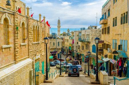 BETHLEHEM, PALESTINE - FEBRUARY 18, 2016: The narrow Pope Paul IV street is the central street of the city, on February 18 in Bethlehem.