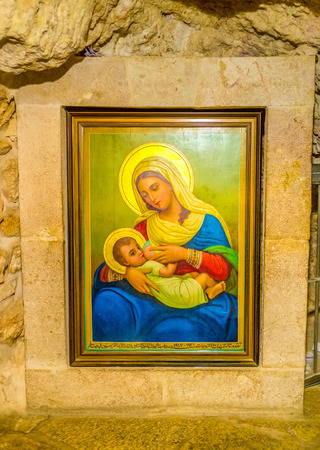 BETHLEHEM, PALESTINE - FEBRUARY 18, 2016: The modern icon of St. Mary and the child in the Milk Grotto, on February 18 in Bethlehem.